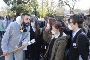 Deniz Vatansever explaining the O2 sensor to secondary school students.