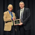 Prof John O'Brien receiving the award from Prof Henry Brodaty, IPA President